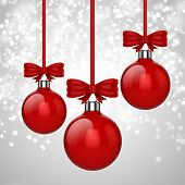3d Christmas ball ornaments with red ribbon and bows, background