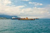 Sea transports - Ferryboat crossing in Brazil transporting vehicles and people