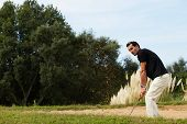 Golfer man playing on beautiful golf course in summer