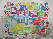 Digital icons and online symbols as internet concept tag cloud on a wall