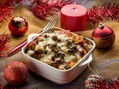 oven pasta over red christmas table