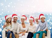 family, happiness, generation, holidays and people concept - happy family in santa helper hats sitti