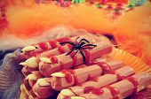 picture of cobweb  - a pile of Halloween fingers with spiders and cobwebs of different colors in the background - JPG