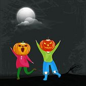 Little cute kids in scary pumpkin face for Trick Or Treat party celebration on scary night view background.