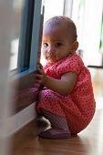 Portrait Of Little African American Little Girl Sitting On The Floor - Black People