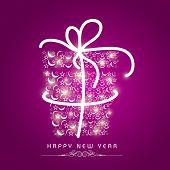Stars decorated gift box wrapped by white ribbon on purple background for Happy New Year 2015 celebrations.