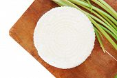 dairy products : feta white cheese on cut board isolated over white background