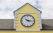 Ten Sixteen On Clock On Yellow Plaster Building