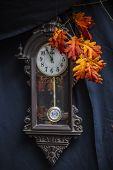 pic of pendulum clock  - Old clock and branch of autumn oak leaf - JPG