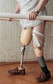 stock photo of amputee  - Male prosthesis wearer training in a special interior area - JPG
