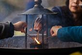 NARA,JAPAN, NOVEMBER 18, 2011: Japanese people are igniting some incense sticks for praying at the Todai-ji temple in Nara near Kyoto, Japan. Focus on the fire, shallow depth of field