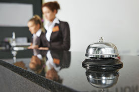 foto of maids  - Modern luxury hotel reception counter desk with bell - JPG