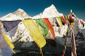 stock photo of dharma  - evening view of Mount Everest with buddhist prayer flags from Kala Patthar way to Everest base camp Nepal - JPG