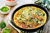 picture of green onion  - baked omelette with spinach dill parsley and green onions on a white wood background - JPG