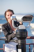Woman with binoculars near seaport