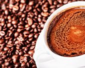 Coffee Cup And  Roasted Coffee Beans  Can Be Used As A Background, Close Up