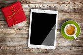 Gift Box, Cup Of Coffee And Digital Tablet On Wooden Background