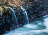 Waterfall Flows Into Sea At Queens Bath Kauai