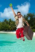 pic of stereotype  - a young attractive male in a colorful outfit in a tropical island setting as a stereotype tourist - JPG