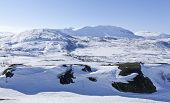 foto of laplander  - Rolling mountain range covered by snow in the Nordic countryside Lapland - JPG