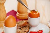 stock photo of baguette  - Soft boiled egg with baguette on wood table