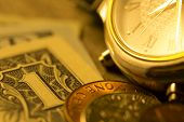 Time And Money. Gold Tone. Close Up - Stock Image