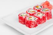 Close-up of Sushi roll with salmon, crab, shrimps and caviar.