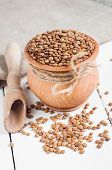 Dry Organic Brown Lentils against a wooden background