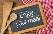 Enjoy your meal written on a blackboard