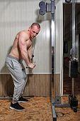 Man trains in gym