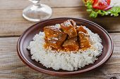 beef stew with white rice and sauce