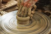 pic of pottery  - Potter makes on the pottery wheel clay pot - JPG