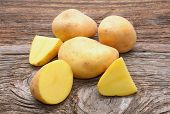 Bunch of potatoes on wooden background