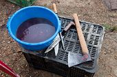 foto of slaughter  - Butcher tools and dirty water bucket for traditional home slaughtering - JPG