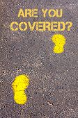 Yellow Footsteps On Sidewalk Towards Are You Covered Message
