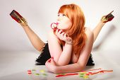 Redhair Girl Holding Sweet Food Jelly Candy On Gray.