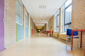 picture of long distance  - Long straight corridor with furniture in school building - JPG