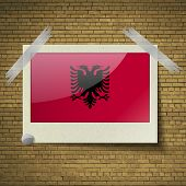 foto of albania  - Flags of Albania at frame on a brick background - JPG