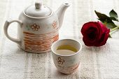 foto of teapot  - fresh healthy hot tea in a teapot and cup whit rose - JPG