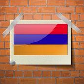 foto of armenia  - Flags of Armenia scotch taped to a red brick wall - JPG
