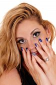 image of fingernail  - A young beautiful woman holding her finger on her face with her blue fingernails isolated for white background - JPG