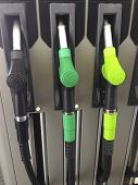 stock photo of petrol  - Detail of hoses of petrol pump at a gas station Spain - JPG