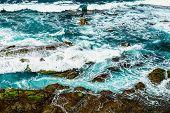 image of atlantic ocean  - Stones in waves of ocean on coast or shore of Atlantic ocean in Tenerife Canary island Spain at spring or summer - JPG