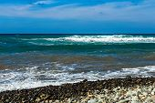 picture of atlantic ocean  - Wild stone beach on coast or shore of the Atlantic ocean with waves and sky with clouds and skyline or horizon in Tenerife Canary island Spain - JPG