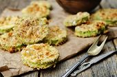 image of crisps  - baked parmesan zucchini crisps on a dark wood background - JPG