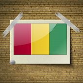 pic of guinea  - Flags of Guinea at frame on a brick background - JPG