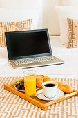 stock photo of bed breakfast  - laptop and breakfast tray in bed hotel - JPG