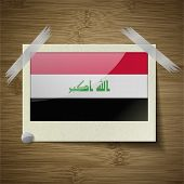 picture of iraq  - Flags of Iraq at frame on wooden texture - JPG