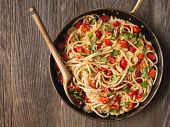 stock photo of cooked crab  - close up of rustic spicy italian crab and cherry tomato spaghetti pasta - JPG