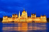 stock photo of hungarian  - Hungarian Parliament Building on the bank of the Danube in Budapest by night - JPG